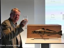 Prof. Guy Duhamel, with a glass of wine after being presented with a superb Patagonian toothfish (caught at Kerguelen Island and preserved by the MNHN taxidermist)